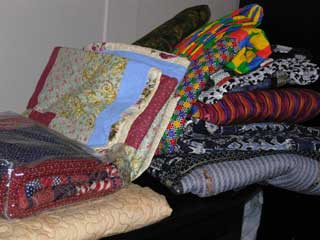 picture of large stack of quilts